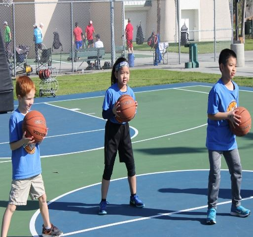 3 children at youth basketball on courts and Sports Park