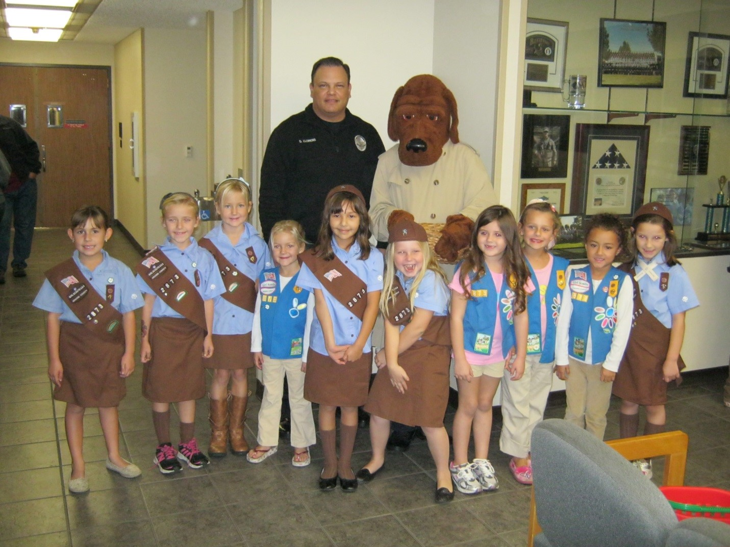 Chief with McGruff and a local group of Brownies