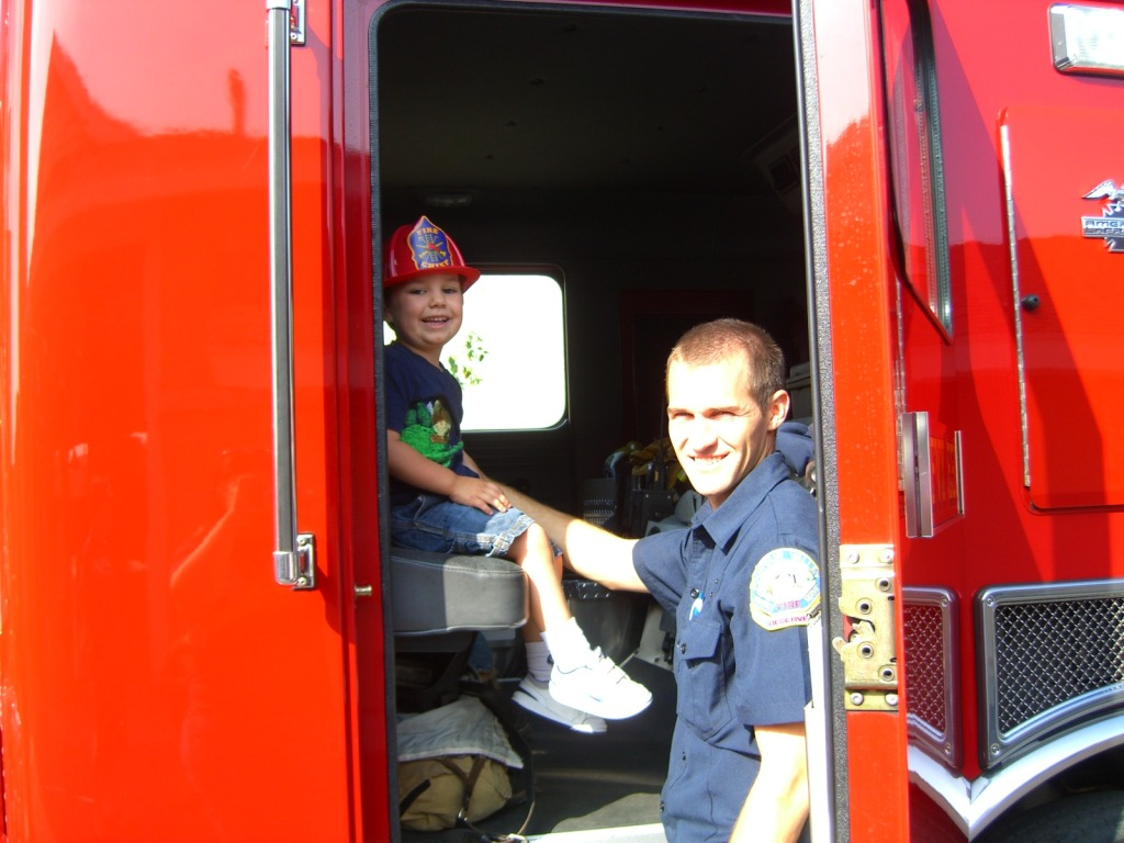 Exploring the fire truck at a community event