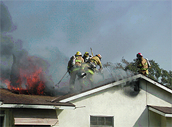 Fighting a house fire on the roof