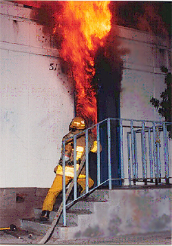 Firefighter going into a burning building